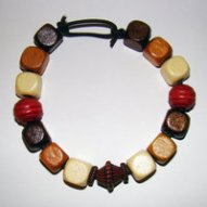 Bracelet Size Large/Adult Male 4.5 in to 5 in Made with Leather Cord, 14 Wood Beads and 1.2 Plastic Beads (.2 are the small beads around the center bead) Price: $5.00