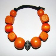 Bracelet Size Small/Child to Large/Adult Male 3.5 in to 4.5 in Made with Leather Cord, 10 Wood Beads and 1 Plastic Bead Price: $5.00