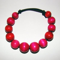 Bracelet Size Medium/Adult Female 3.5 in to 4 in Made with Leather Cord and 24 Wood Beads Price: $5.00